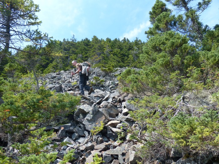 Bill climbing the talus slope